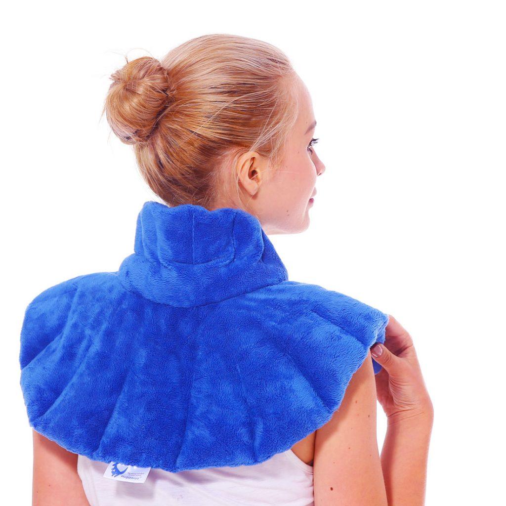 woman wearing Huggaroo neck wrap, managing chronic pain