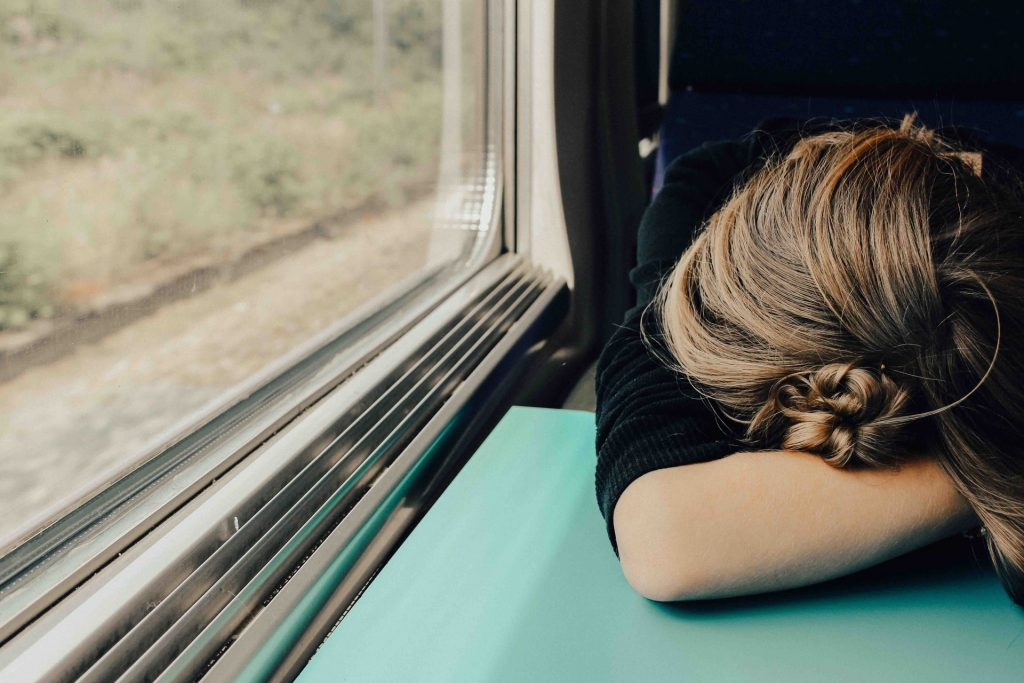 tired girl on a train